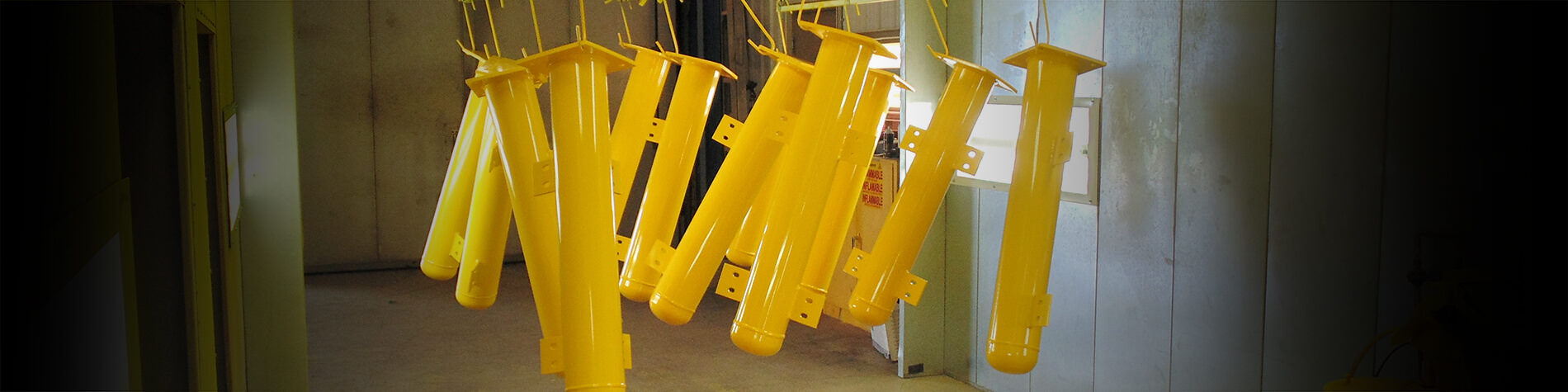 Items hung to dry after powder coating